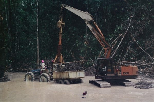 Bulk sampling for diamonds using a Poclain digger, near to the Mazaruni River, Guyana. When it rained, it rained.